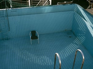 An empty pool on the ship with a chair in the middle