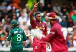 West Indies' Oshane Thomas celebrates taking the wicket of Pakistan's Mohammad Hafeez.