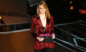 Emma Stone speaks onstage presenting the best director award.