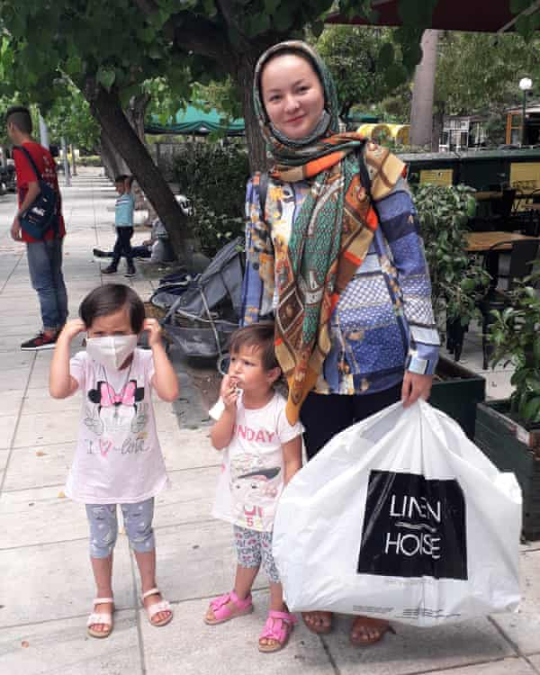 Sarah Husseini with her daughters in Victoria Square, Athens.