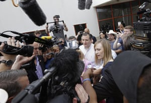 Ted Cruz is surrounded by media before voting in the Texas primary.