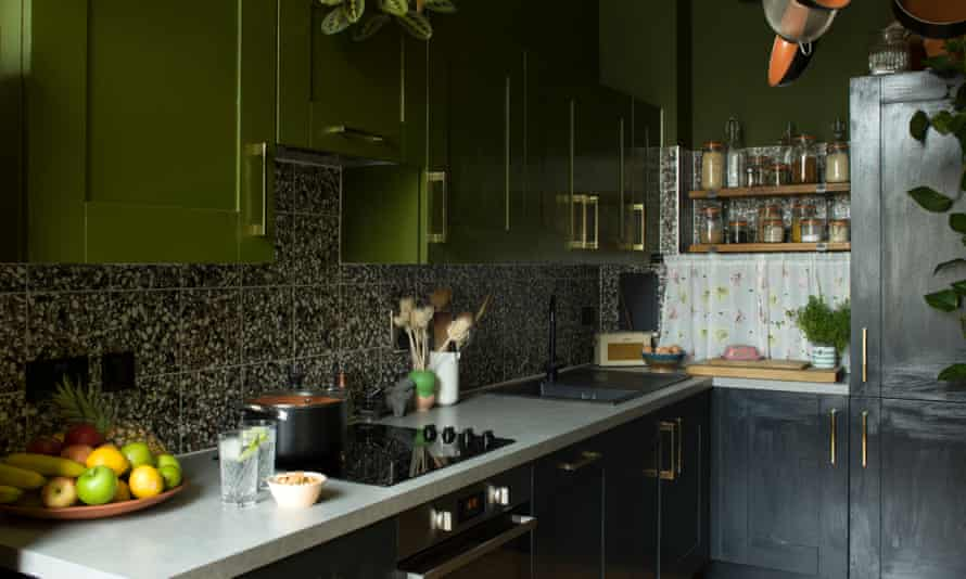 Cooking up a storm: green and black painted units in the kitchen.