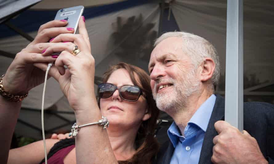 Jeremy Corbyn with a member of the public at a Labour leadership campaign rally in Hull.
