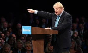 Boris Johnson on stage giving his speech at the Conservative party conference at the Manchester convention centre