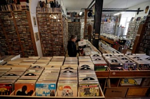 Petr Rakosnik, an owner of a music store, sorts vinyl records in his closed shop in Prague, Czech Republic, on 17 February, 2021.