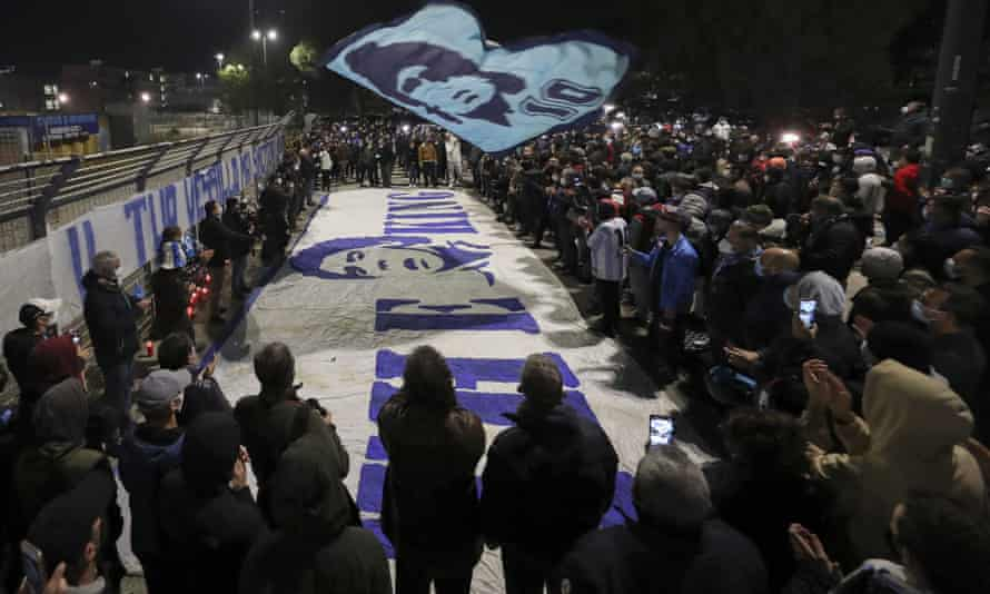 Giant banners are prepared outside San Paolo stadium in Naples.