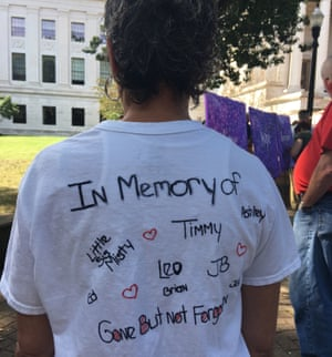 Stephanie Hopkins wearing a T-shirt bearing her sister Misty's picture. Misty was a nurse who died of a heroin overdose. On the back of the T-shirt are the names of eight people Stephanie knows who have died from opioid overdoses.