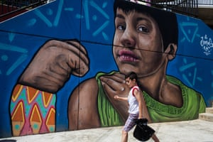 A young boy walks past a huge work of art