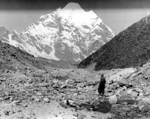 Hillary studies Himalayan peaks from Berun Valley base camp 1954.