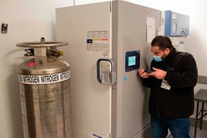 A technician is making adjustments to the vaccine freezer at Mount Sinai hospital in New York on 9 December 2020, ahead of an expected Pfizer COVID-19 vaccine shipment over the weekend. An initial shipment of 975 doses, to be stored in this freezer at -80 degrees celsius (-112 Fahrenheit), will be administered to hospital workers including ICU, ER and EMS staff.