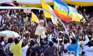 Crowds cheer Pope Francis in Uganda.