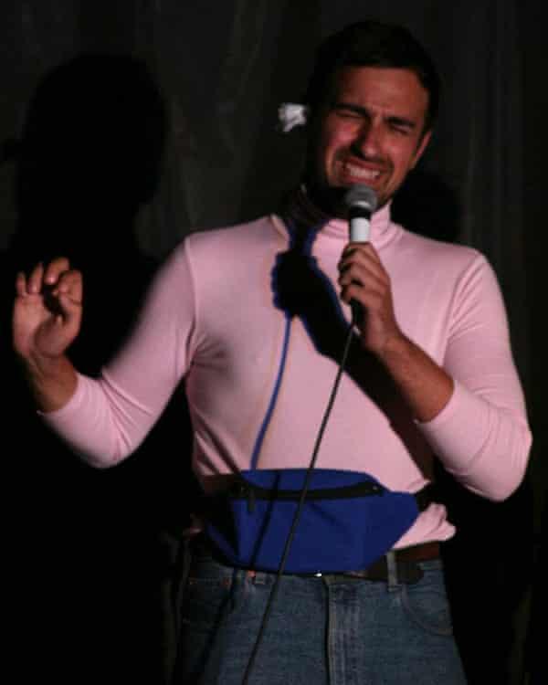 Demetriou performing on stage.