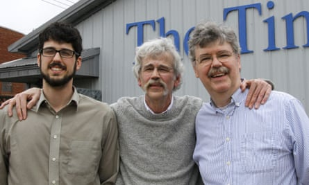 Art Cullen, centre, with his son, Tom, left, and brother, John, outside the Storm Lake Times office in Iowa after winning the Pulitzer prize