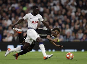 Tottenham's Davinson Sanchez, front, tussles for the ball with Ajax's David Neres.