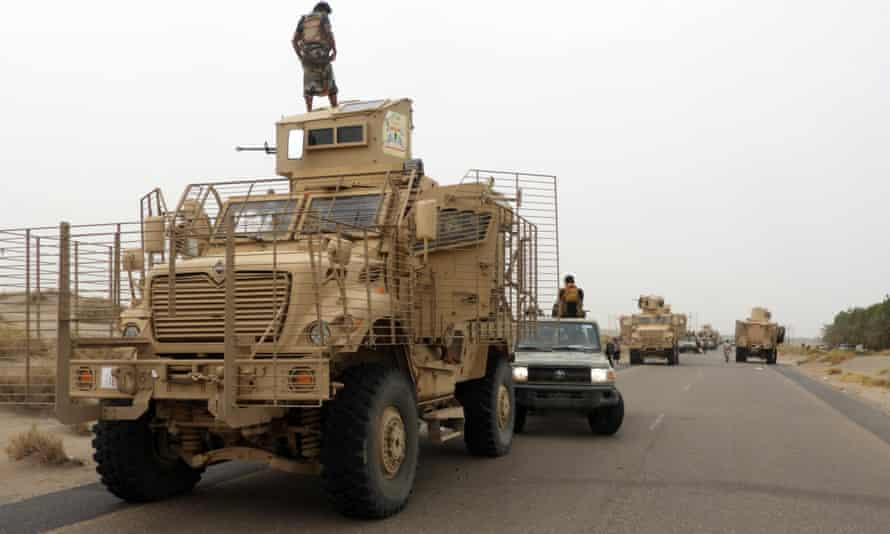 Troops in armoured vehicles