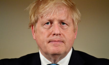 Boris Johnson looks on during a coronavirus news conference inside number 10 Downing Street.