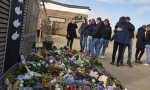 Surfers gather at the Scheveningen surf school to lay tributes.