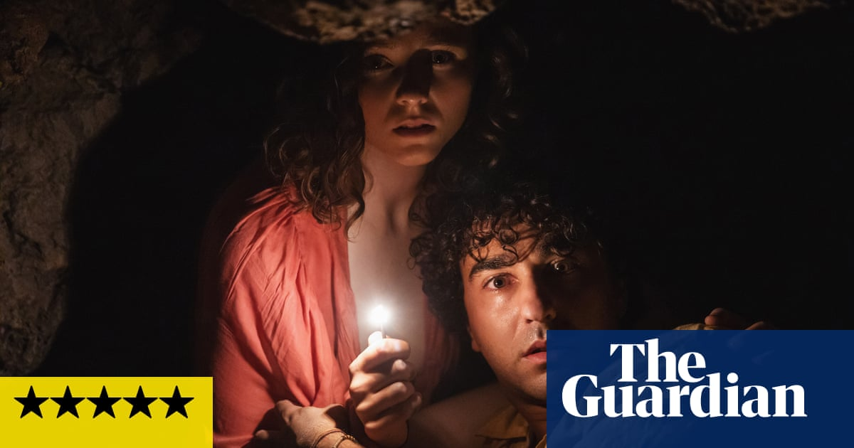 Old review – M Night Shyamalan's fast-ageing beach horror is top notch hokum
