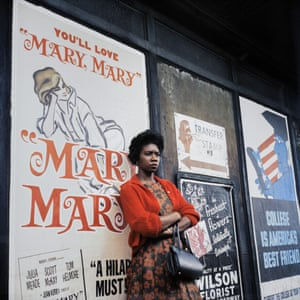 Woman standing in front of poster for Mary Mary