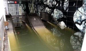 An escalator under water at a subway station in New York after Hurricane Sandy