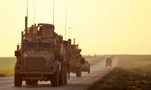 US Marine Corps tactical vehicles are seen driving along a road near Tal Baydar in Syria's north-eastern Hasakeh province.