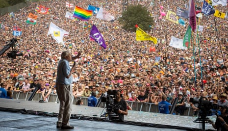 David Attenborough addresses the crowds from the Pyramid Stage. Glastonbury Festival, 2019