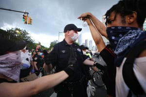 Police confront protesters in front of the Barclay's Center in Brooklyn on May 29, 2020 in New York City. Minneapolis Police officer Derek Chauvin was filmed kneeling on George Floyd's neck. Floyd was later pronounced dead at a local hospital. Across the country, protests against Floyd's death have set off days and nights of rage as its the most recent in a series of deaths of black Americans by the police.