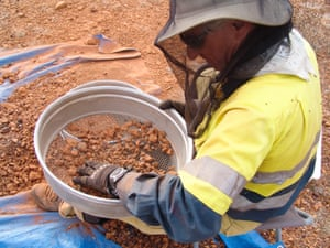 Gary Luchi sieving, in trench four at Boulia, Central Queensland