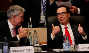 Steven Mnuchin gestures as he talks with Federal Reserve chairman Jerome Powell in Fukuoka, Japan.