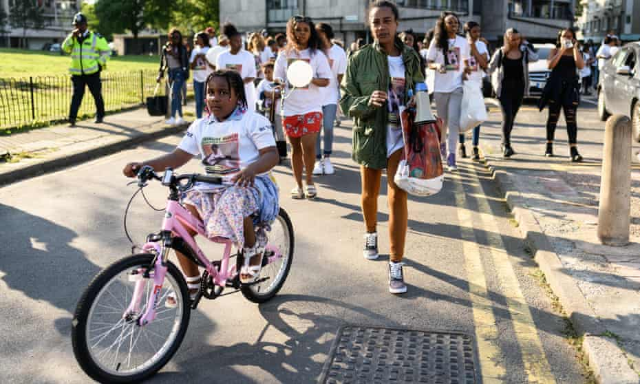 Pretana Morgan, Rhyhiem Barton's mother, walks with her daughter at the start of a solidarity march in May 2018.