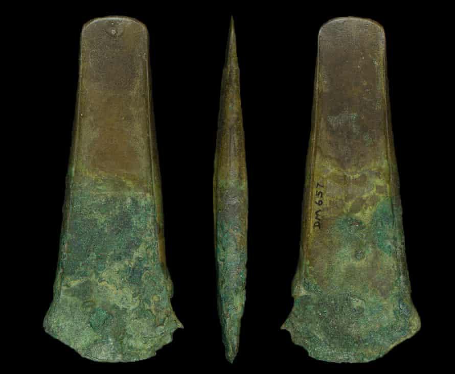 A bronze age flanged axe found alongside a human bone musical instrument.