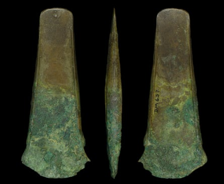 A bronze age flanged axe found alongside a human bone musical instrument.