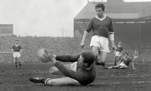 Wilf McGuinness watches Manchester United teammate Harry Gregg save a shot in a 1959 victory over Everton.