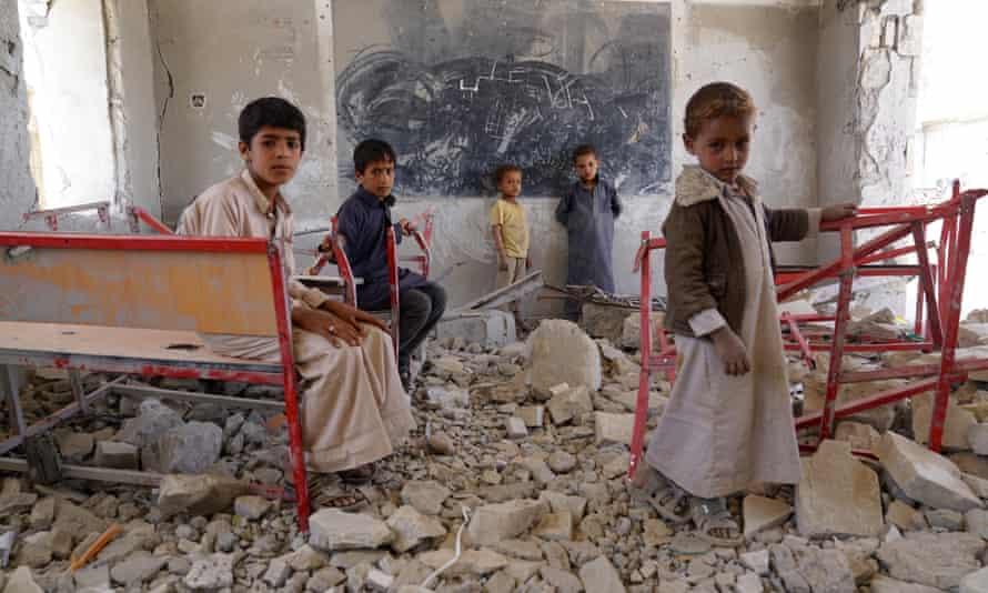 Children amid the ruins of a classroom at Aal Okab school in Sa'ada, Yemen
