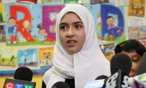 Khawlah Noman speaks to reporters in Toronto.