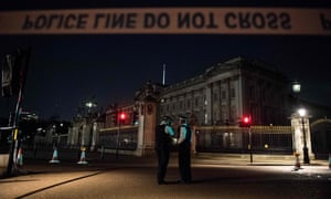 Police officers outside Buckingham Palace in London following the alleged attack on 25 August