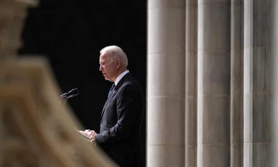President Joe Biden speaks during the funeral service for former Virginia senator John Warner at the Washington National Cathedral on Wednesday.