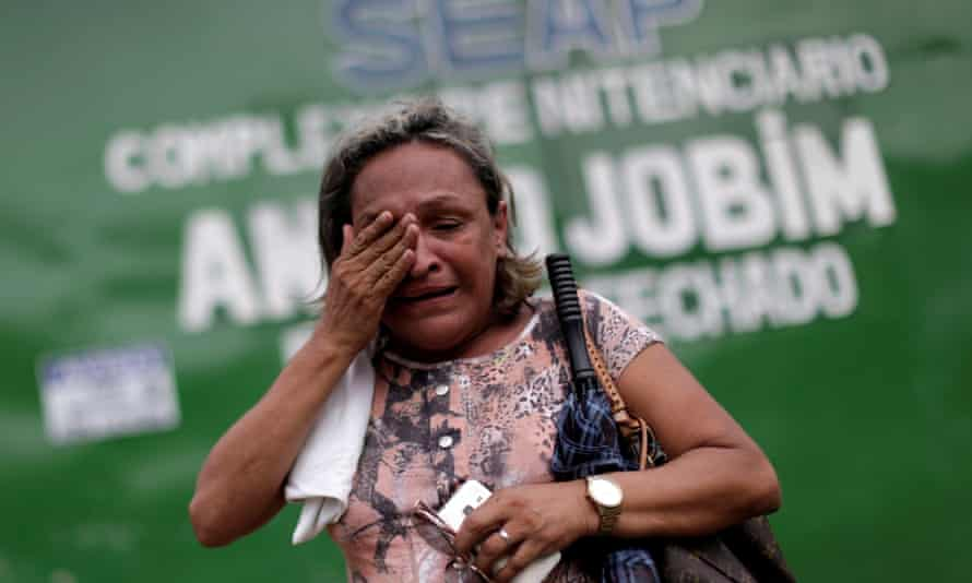 A relative of a prisoner reacts in front of the main entrance of Anísio Jobim prison in Manaus on 3 January after a riot in which 56 prisoners were butchered.