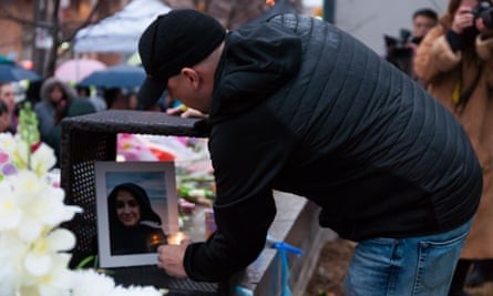 People leave flowers and messages at a memorial to the victims of the Yonge Street massacre in Toronto, Canada.