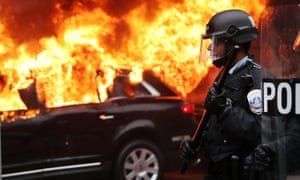 Police and demonstrators clash in downtown Washington after a limo was set on fire following Trump's inauguration in January.