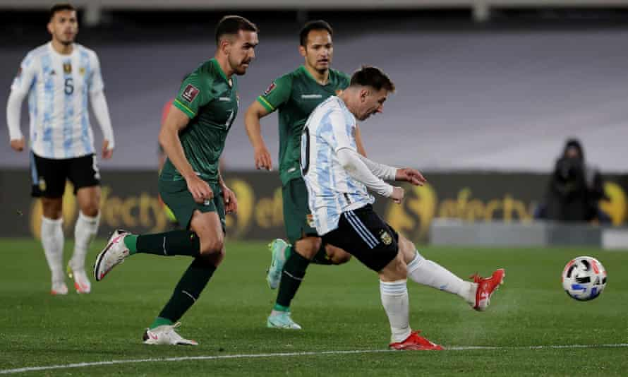 Messi fires home his first goal against Bolivia.
