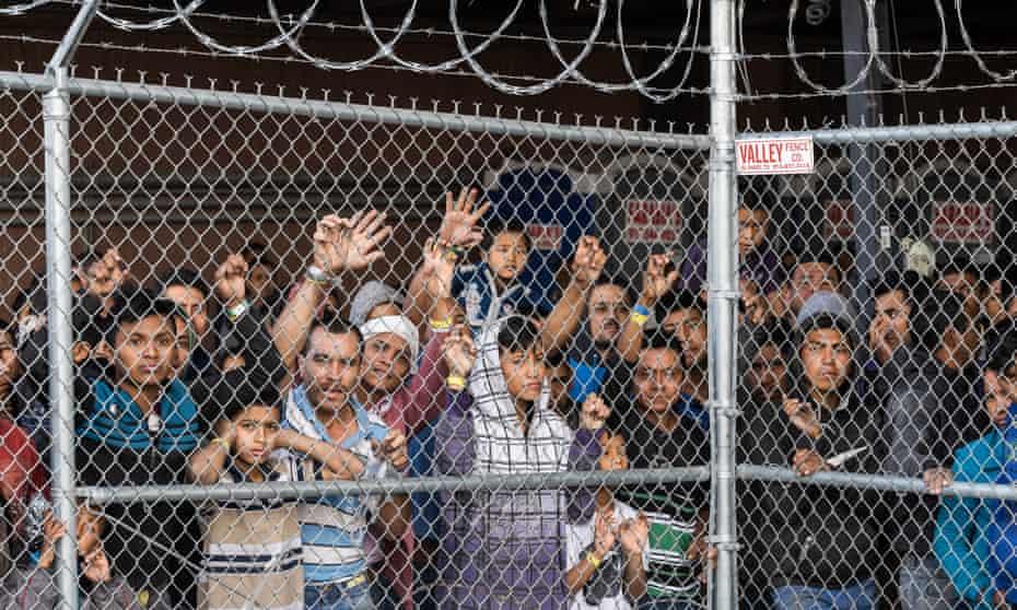 Migrants are held for processing under the Paso del Norte Bridge in El Paso.