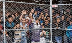 Migrants being held for processing under the Paso del Norte bridge in El Paso, Texas on 27 March.
