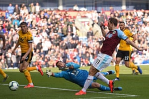 Burnley's striker Chris Wood shoots past Wolves' goalkeeper Rui Patricio and his shot hits the post before going in off Wolves' Conor Coady (left) for an own-goal.