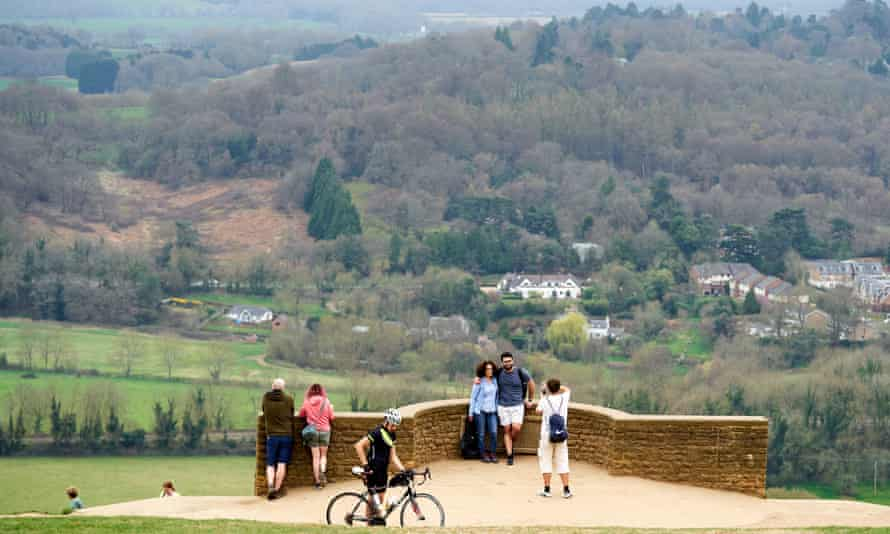 People enjoy the warm weather at Box Hill in Surrey