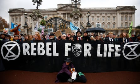 Demonstrators stand outside the gates of Buckingham Palace, during an Extinction Rebellion protest, central London