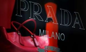 A handbag is displayed in the window of a Prada store in Hong Kong
