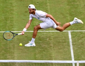 Joao Sousa stretches for a forehand.