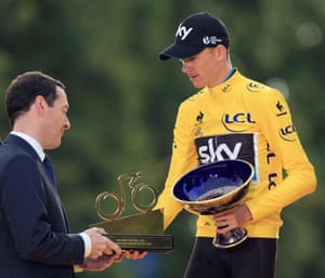 Froome receives a trophy from Chancellor George Osborne.