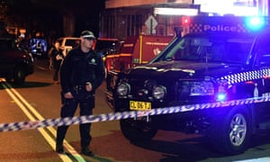 Police man a checkpoint during a raid in the Sydney inner suburb of Surry Hills on Saturday, 29 July.
